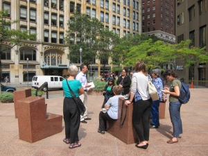 Curator Brian Land leads a tour of Chairs for Six by Scot Burton | Photo courtesy the Pittsburgh Office of Public Art